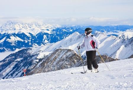 Alpine skier mountains in the background. Ski resort of Kaprun, Kitzsteinhorn glacier. Austria photo