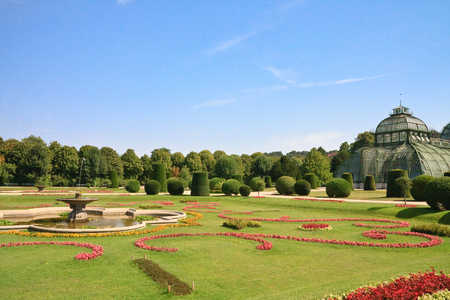 schonbrunn palace: Palm Pavilion and floral lawn in the park of Schonbrunn, Vienna, Austria