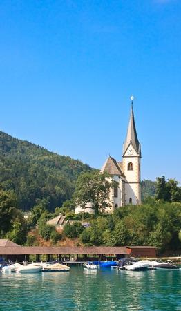 Resort Maria Worth. Kerk van St. Primus en Felician. Oostenrijk
