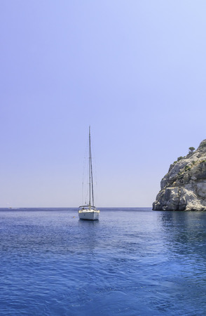 Yacht in the blue sea. Rhodes Island. Greece photo