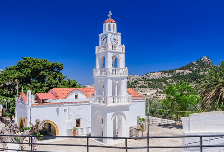 Mother Mary: Church  with a bell tower. Kato Monastery Tsambika. Rhodes Island. Greece Stock Photo