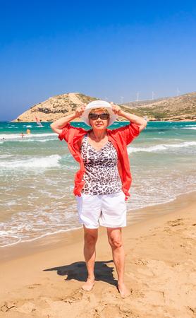 isthmus: Woman on the beach of the isthmus Prasonisi. Rhodes Island. Greece