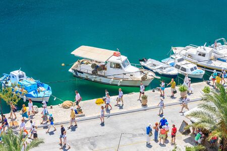 ano: Tourists in the capital of the island of Symi - Ano Symi. Greece Editorial