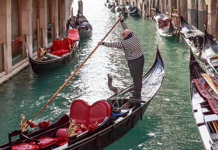 gondolier: Italy. Venice. Gondolier