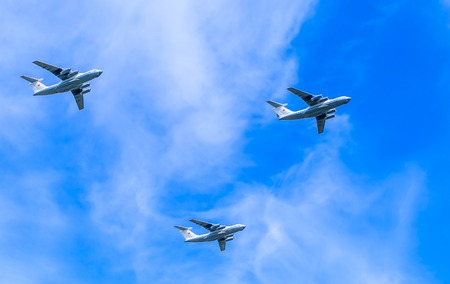 aniversary: MOSCOWRUSSIA - MAY 9: 3 Ilyushin Il-76 (Candid) multi-purpose four-engined strategic airlifters fly onf parade devoted to 70-th Victory Day aniversary on May 7, 2015 in Moscow.