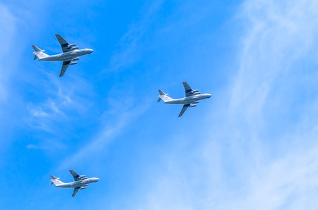may fly: MOSCOWRUSSIA - MAY 9: 3 Ilyushin Il-76 (Candid) multi-purpose four-engined strategic airlifters fly onf parade devoted to 70-th Victory Day aniversary on May 7, 2015 in Moscow.