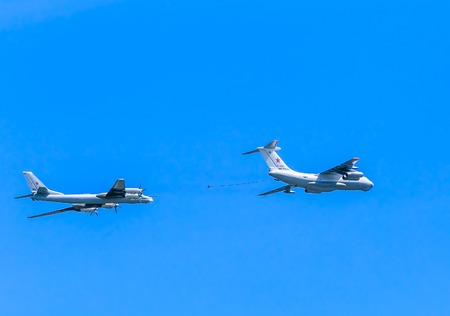 MOSCOWRUSSIA - MAY 9: Il-78 (Midas) aerial tanker and Tu-95MS (Bear) large strategic bombers and missile platform demonstrate refueling on parade devoted to Victory Day on May 9, 2015 in Moscow.