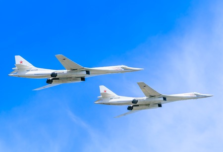 coincidence: MOSCOWRUSSIA - MAY 9: 2 Tupolev Tu-22M3 (Backfire) supersonic swing-wing long-range strategic and maritime strike bombers fly on parade devoted to Victory Day aniversary on May 9, 2015 in Moscow. Editorial