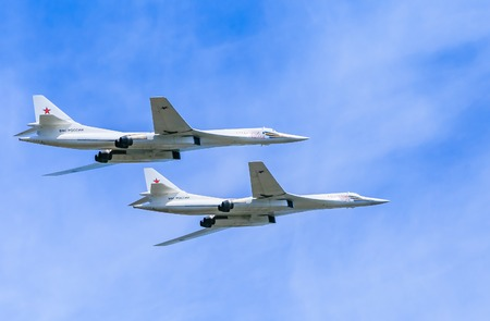 may fly: MOSCOWRUSSIA - MAY 9: 2 Tupolev Tu-22M3 (Backfire) supersonic swing-wing long-range strategic and maritime strike bombers fly on parade devoted to Victory Day aniversary on May 9, 2015 in Moscow. Editorial