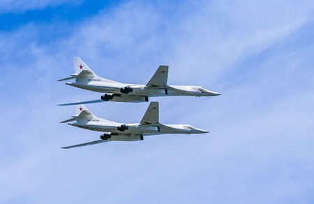 pilotage: MOSCOWRUSSIA - MAY 9: 2 Tupolev Tu-22M3 (Backfire) supersonic swing-wing long-range strategic and maritime strike bombers fly on parade devoted to Victory Day aniversary on May 9, 2015 in Moscow. Editorial