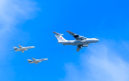 MOSCOWRUSSIA - MAY 9: Il-78 (Midas) aerial tanker demonstrates refueling of 2 Su-24 (Fencer) supersonic attack aircrafts on parade devoted to 70-th Victory Day aniversary on May 9, 2015 in Moscow. Editorial