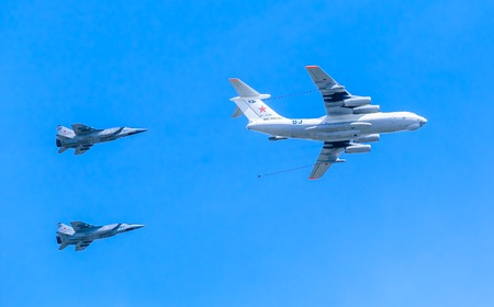 MOSCOWRUSSIA - MAY 9: Il-78 (Midas) aerial tanker demonstrates refueling of 2 MiG-31 (Foxhound) supersonic interceptors on parade devoted to 70-th Victory Day aniversary on May 9, 2015 in Moscow.