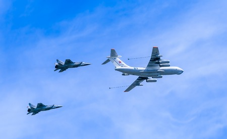 mig: MOSCOWRUSSIA - MAY 9: Il-78 (Midas) aerial tanker demonstrates refueling of 2 MiG-31 (Foxhound) supersonic interceptors on parade devoted to 70-th Victory Day aniversary on May 9, 2015 in Moscow.
