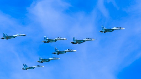 aniversary: MOSCOWRUSSIA - MAY 9: 8 Sukhoi Su-30SM (Flanker-C) and Su-35 (Flanker-E) twin-engined supermaneuverable multirole fighters on parade devoted to 70-th Victory Day aniversary on May 9, 2015 in Moscow.