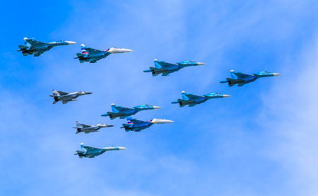 mig: MOSCOWRUSSIA - MAY 9: 4 Su-34 Fullback bombers, 4 Su-27 Flanker supermanoeuverable and 2 MiG-29 Fulcrum jet fighters form Tactical Wing on parade devoted to Victory Day on May 9, 2015 in Moscow.
