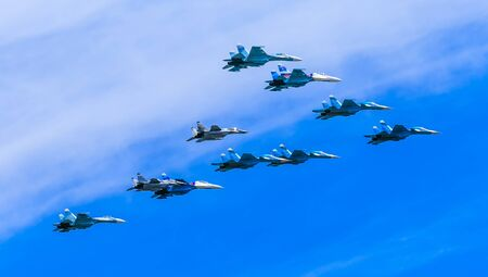 fulcrum: MOSCOWRUSSIA - MAY 9: 4 Su-34 Fullback bombers, 4 Su-27 Flanker supermanoeuverable and 2 MiG-29 Fulcrum jet fighters form Tactical Wing on parade devoted to Victory Day on May 9, 2015 in Moscow.