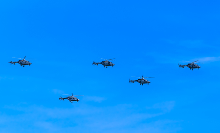 may fly: MOSCOWRUSSIA - MAY 7: 5 Mi-8AMTK (Hip) medium transport helicopters fly on rehearsal of parade devoted Victory Day on May 7, 2015 in Moscow.
