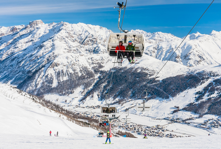 LIVIGNO, ITALY - JANUARY 28, 2015: Ski lift and ski slopes in the mountains of winter resort Livigno, Lombardi, January 28, 2015, Italy. Livigno is developing ski resort in northern Italy