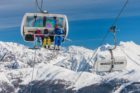 LIVIGNO, ITALY - JANUARY 28, 2015: Ski lift in the mountains of winter resort Livigno, Lombardi, January 28, 2015, Italy. Livigno is developing ski resort in northern Italy