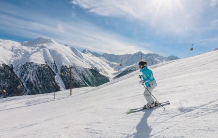 Skier on the slope of  Ski resort Livigno. Italy