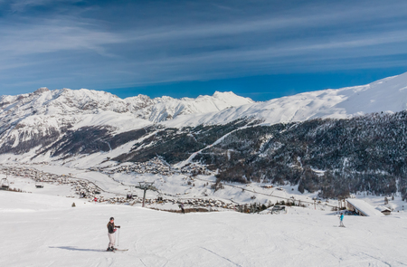 skiers: Skiers on the slope of  Ski resort Livigno. Italy