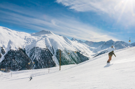 ski track: Skiers on the slope of  Ski resort Livigno. Italy