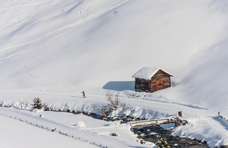 commune: House in the mountains. Ski resort Livigno. Italy Stock Photo