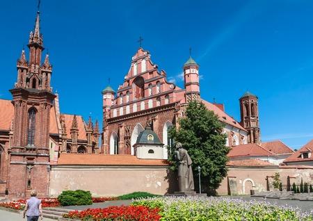 sightseers: A monument to Adam Mickiewicz, Catholic church of St. Annes and Church  Bernardine. Vilnius, Lithuania Stock Photo