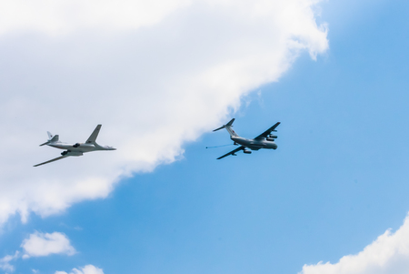 aniversary: MOSCOWRUSSIA - MAY 7: Il-78 (Midas) aerial tanker and Tu-160 (Blackjack) supersonic heavy strategic bomber demonstrate refueling on rehearsal of parade devoted to Victory Day aniversary on May 9, 2016 in Moscow.