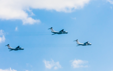 may fly: MOSCOWRUSSIA - MAY 7: 3 Ilyushin Il-76MD (Candid) multi-purpose four-engined strategic airlifters fly onf parade devoted to 701-th Victory Day aniversary on May 7, 2016 in Moscow. Editorial