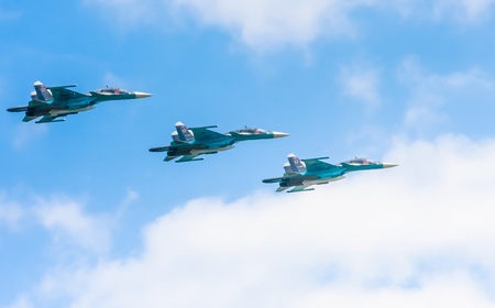 aerobatic: 3 Sukhoi Su-34 (Fullback) twin-seat fighter-bomber aircrafts on rehearsal of parade devoted to 71-th Victory Day aniversary on May 9, 2016 in Moscow.