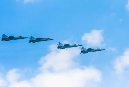 distal: MOSCOWRUSSIA - MAY 7: 4 Mikoyan-Gurevich MiG-31 (Foxhound) supersonic interceptor aircrafts  on  rehearsal of parade devoted to 7-th Victory Day aniversary on May 7, 2016 in Moscow