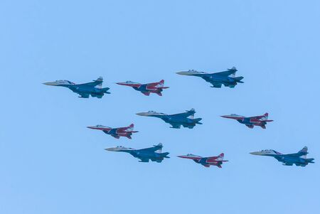 aniversary: MOSCOWRUSSIA - MAY 9: Diamond-shape of 4 Mig-29 The Russian Knights and 5 Su-27 Swifts on  parade devoted to 71-th Victory Day aniversary on May 9, 2016 in Moscow