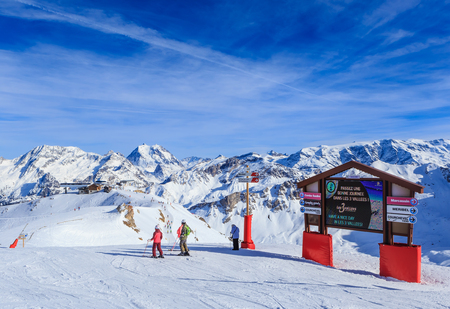 skiers: Skiers standing at the Pointers to the track in the ski resort Courchevel. France