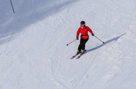 striving: Skier on the slopes of the ski resort