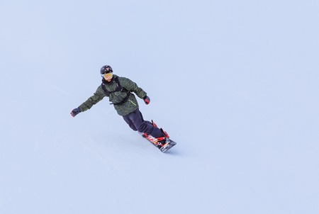 Snowboarder on the slopes of the ski resort Editorial