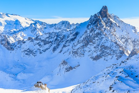 Skiers on the slopes of the ski resort of  Courchevel. France