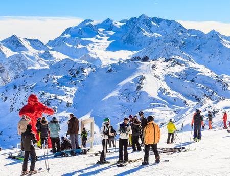 king kong: Group of skiers around the sculpture King Kong sculpture sculptor Richard Orlinski about Saulire cable car. Ski Resort Kurchevel. France Editorial