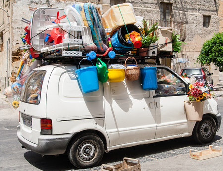 The car is fully loaded with luggage. Sicily, Italy Stock Photo