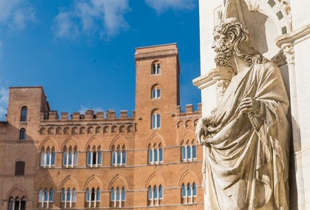 cappella: Statue of the Cappella di Piazza  and Sansedoni Palace. Siena, Tuscany. Italy