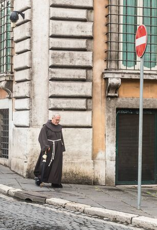 lowered: Monk on the street of Rome. Italy Editorial