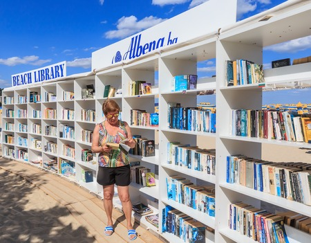 owning: Woman near free beach library opened  at the Black Sea resort of Albena. Bulgaria