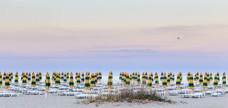 The Black Sea shore,  beach with sand, umbrellas and sunbeds. Morning. Resort Albena, Bulgaria Stock Photo