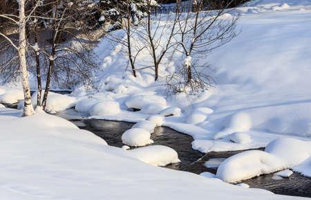 Belokurikha river in winter. Resort Belokurikha, Altai. Russia