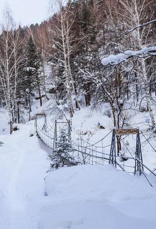 Cable suspension Bridge over Belokurikha river. Resort Belokurikha. Altai, Russia