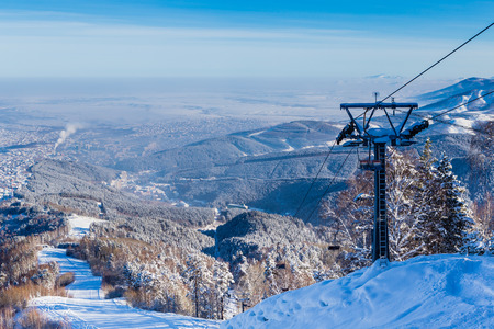 mountainside: The ski slope on Tserkovka mountain in the city the resort of Belokurikha, Altai, Russia  Stock Photo