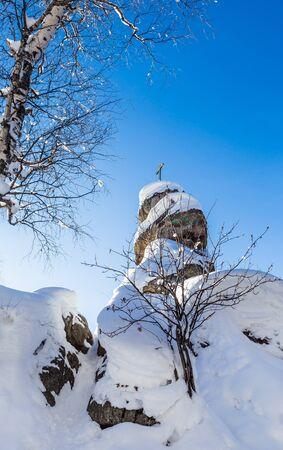 A rock with an Orthodox cross. Mountain Church. Resort Belokurikha, Altai, Russia Stock Photo