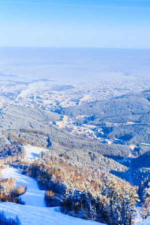 View from Tserkovka mountain to the resort town of Belokurikha in winter, Altai, Russia
