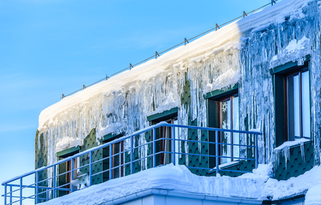 Lcicles on the roof and wall of the house & Ice Canopy Stock Photos. Royalty Free Business Images