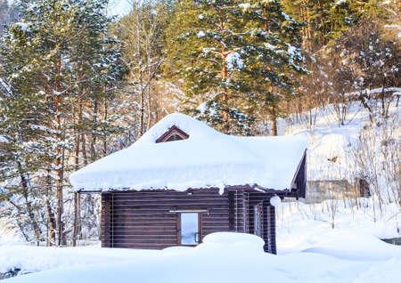 Wooden hut in the snow. Belokurikha, Altai, Russia Stock Photo